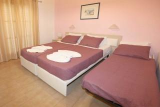 triple room villa katerina bedroom